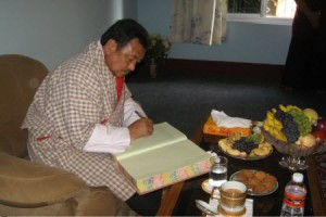Bhutanese Minister Signing Namdroling Guest Book